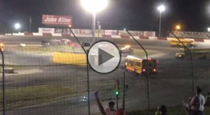 An interesting school bus race at Elko Speedway ends in roll over!