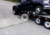 The worst truck loading on a trailer ever! He ruined a perfectly good Pick up!