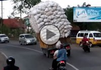 Crazy traffic fail! Overloaded truck flips over!