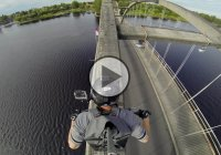 Extreme Riding On Top Of A Bridge – Don't Try This At Home… Unless You Are A Professional Stuntman.