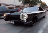 An all black 1965 Cadillac DeVille lowrider, shiny and beautiful!