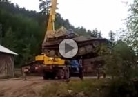 Lifting a tank with a crane. What could possibly go wrong?