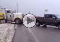 Dodge Ram pulling a semi truck from the snow easy and effortlessly!