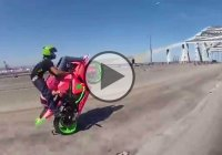 Couple Performs A 69 Motorcycle Wheelie – Amazing Skills!!