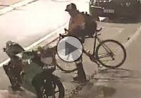 Bicyclist caught on cam kicking a motorcycle! JEALOUS MUCH?
