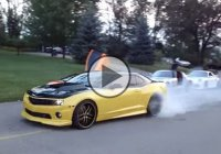 The owner of a cool car collection is doing burnouts with his Camaro!