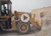 5 year old kid operating a loaded excavator like a pro!