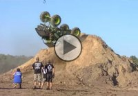 Cory Rummell doing a backflip with a mud truck at Going Deep!