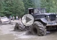 5 ton bobbed Deuce with tractor tires, pulling a mud bogging Ford truck!