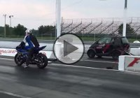 A snowmobile-powered turbocharged Smart car slaying a motorcycle at the strip!