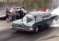 Pontiac GTO running on nitrous against a Mazda RX7 with a huge turbo!