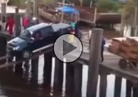 Crazy driver uses planks of wood to load his truck onto a ferry!!
