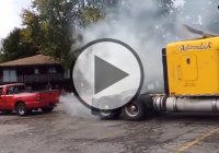 Tug of war between Chevy Silverado dually pickup truck and a semi-truck!