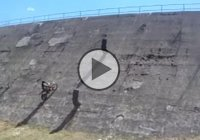 Dirt Biker Tries To Overtake A Dam – Will He Make It??
