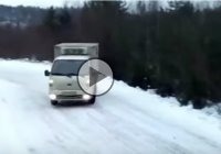 Amazing snow drift performed by a delivery truck!