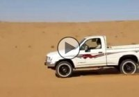 Pickup truck vs. vertical sand dune in Saudi Arabia!