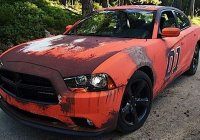 Brand new Dodge Charger wrapped in General Lee camouflage!