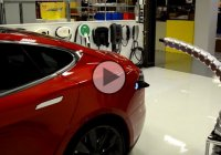 Tesla's robotic charger automatically plugs into the electric vehicle!