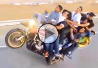 This Is Crazier Than Crazy! – 11-Person Motorcycle Wheelie!