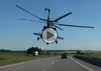 MI 17 helicopter flying incredibly low above a highway in Dnepropetrovsk, Ukraine!