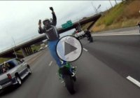 Motorcycle Rider Stands Backwards On His Motorcycle On The Highway – Is He Insane?