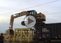 Masterful Control – Caterpilar Climbing Onto A Rail Car!