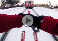 Extreme Russian skiing : Skier hitches onto a speeding train!