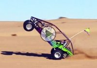 Awesome sandrail wheelie pulled off by a kid is mind-blowing!