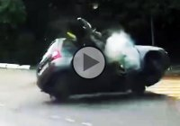 Insanely fast biker almost flips a car after slamming into it!