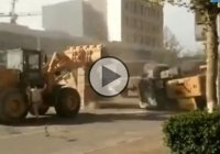 Crazy bulldozer death match on the streets of China!!!