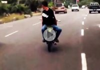 Biker rides backwards and hands free but karma hits him hard!!!