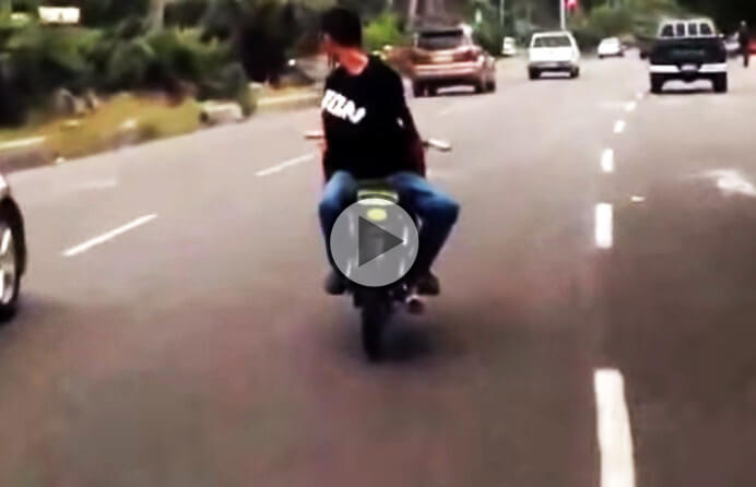 Biker rides backwards