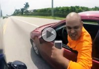 Furious road rage driver tries to ram into a biker!