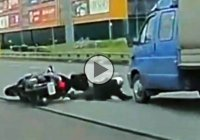 Lucky biker escapes death by mere inches!