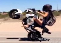 This Lady is doing Wheelies better than you!!!
