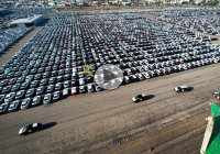Unsold new cars lay on vast parking lots for eternity!