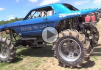 Ford Mustang mud bogger tearing up the muddy terrain!