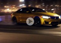 BMW M4 tearing its way through a futuristic racetrack ladnscape!