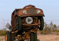 Wheelstanding truck with a backward engine pops an amazing wheelie